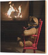 Old Teddy Bear Sitting Front Of The Fireplace In A Cold Night Wood Print