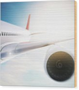 Passenger Airplane Flying At Sunshine, Blue Sky. Wood Print