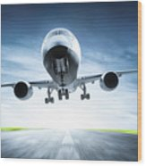Passenger Airplane Taking Off On Runway Wood Print