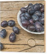 Plate Full Of Fresh Plums On A Wooden Background Wood Print