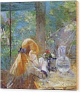 Red-haired Girl Sitting On A Veranda Wood Print