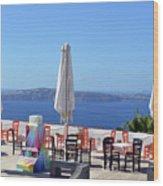 Restaurant By The Aegean Sea  In Santorini, Greece  Wood Print