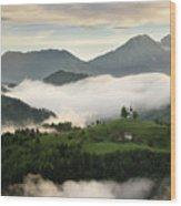Rolling Fog At Sunrise In The Skofjelosko Hills With St Thomas C Wood Print