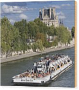 Sightseeing Boat On River Seine To Louvre Museum. Paris Wood Print by Bernard Jaubert