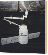 The Spacex Dragon Cargo Craft Prior Wood Print