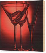Three Empty Cocktail Glasses On Red Background Wood Print