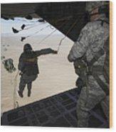 U.s. Airmen Jump From A C-130 Hercules Wood Print