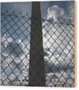 Washington Monument Through Fence Wood Print