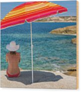 Woman In Red Bikini And White Hat Under Parasol Looking Out To S Wood Print