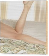Woman Lying On Bed With Us Dollars Wood Print