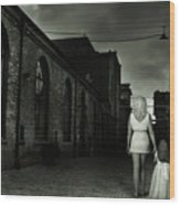 Woman Walking Away With A Child Wood Print