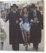 Wyatt Earp  Doc Holiday Escort  Woman  With O.k. Corral In  Background 2004 Wood Print