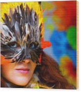 Young Woman With A Colorful Feather Carnival Face Mask On Bright Colorful Background Eye Contact Wood Print