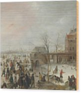 A Scene On The Ice Near A Town Wood Print