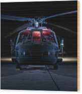 A Uh-60 Black Hawk Helicopter Lit Wood Print