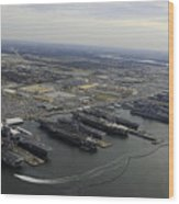 Aircraft Carriers In Port At Naval Wood Print by Stocktrek Images