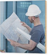 Architect Builder Studying Layout Plan Of The Room Wood Print