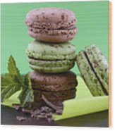 Chocolate And Mint Flavor Macaroons On Dark Wood Table Wood Print