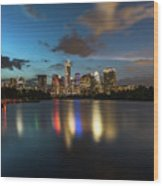 Clouds Roll Over The Austin Skyline As The Neon Reflects In The Glass-like Waters Of Lady Bird Lake Wood Print