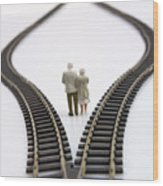 Figurines Between Two Tracks Leading Into Different Directions Symbolic Image For Making Decisions. Wood Print