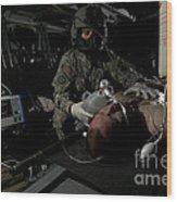 Flight Medic Looks After A Mock Patient Wood Print