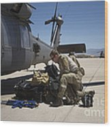 Pararescuemen Sorts Out His Gear Wood Print