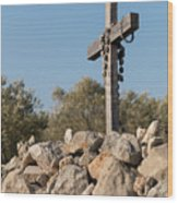 Rosary Hanging On A Small Wooden Cross On A Stone Wall Wood Print