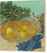 Still Life Of Oranges And Lemons With Blue Gloves Wood Print