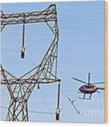 Stringing Power Cable By Helicopter Wood Print