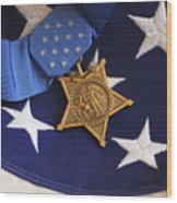 The Medal Of Honor Rests On A Flag Wood Print