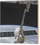 The Spacex Dragon Cargo Craft Wood Print by Stocktrek Images