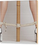 Woman Legs Tied With Ropes To Bamboo Wood Print