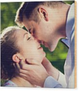 Young Romantic Couple Kissing With Love In Summer Park Wood Print