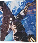 A Space Station Orbiting Above The Earth Wood Print by Stockbyte