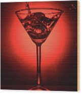 Cocktail Glass With Splashes On Red Background Wood Print