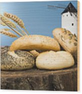 Different Breads And Windmill In The Background Wood Print by Deyan Georgiev