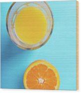 Glass Of Orange Juice And Half Of Orange Wood Print