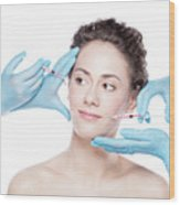 Young Woman Having Botox Face Injections. Wood Print