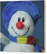 A Cute Little Soft Snowman With A Blue Hat And A Colorful Scarf Wood Print