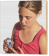 Diabetic Child With Blood Glucose Tester Wood Print
