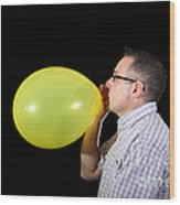 Man Inflating Balloon Wood Print