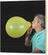 Man Inflating Balloon Wood Print