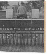 A Farmer Driving A Tractor Wood Print