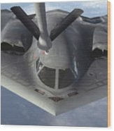 A B-2 Spirit Bomber Prepares To Refuel Wood Print
