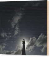 A Backlit View Of A Lighthouse Built Wood Print by Raul Touzon