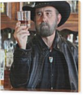 A Bearded Cowboy In Black Contemplates His Whiskey In A Saloon Wood Print
