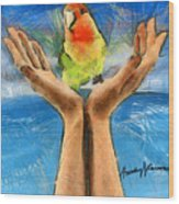 A Bird In Two Hands Wood Print