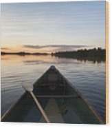 A Boat And Paddle On A Tranquil Lake Wood Print