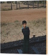 A Boy In Burma Looks Towards A Train From The Shadows Wood Print