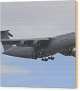 A C-5 Galaxy In Flight Over Nevada Wood Print by Remo Guidi